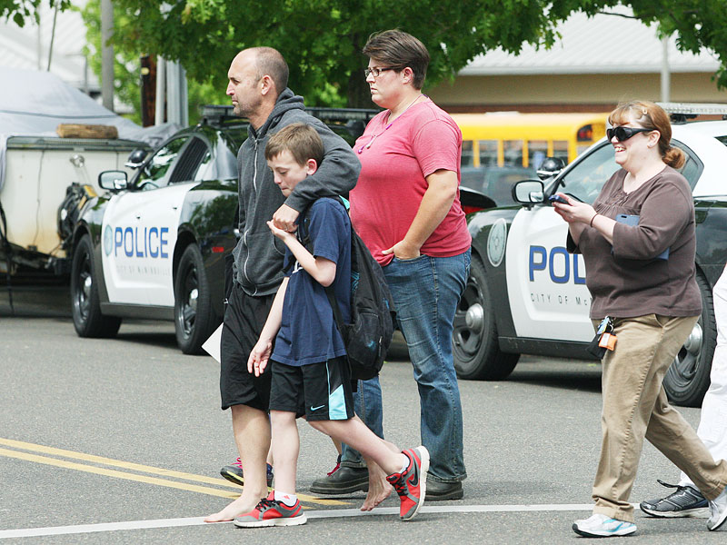Rockne Roll/News-Register##A family departs Grandhaven Elementary School in McMinnville following a