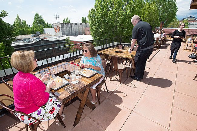 Marcus Larson/News-Register##Patty Durfee and Bernadette Hermens enjoy lunch on the balcony of the newly opened restaurant, the 1882 Grille.