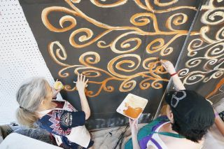 Rockne Roll/News-Register##Nadya King, left, and Terra Stein paint in a section of Sepha Nisbet s Witness Tree in the Currents Back Door Studio in McMinnville.
