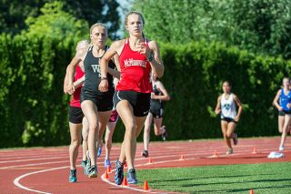 Marcus Larson/News-Register##McMinnville senior Whitney Rich (center) set a school record (4 minutes, 39.24 seconds) to win the girls' 1,500-meter final at the Class 6A Greater Valley Conference Track and Field Championships Friday at Wortman Stadium.