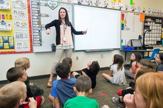 Marcus Larson/News-Register##Ashley Allen leads her Memorial Elementary School class in a math exercise. She and other McMinnville educators say developing relationships with students is the key to good teaching.