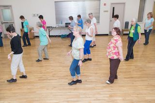 Marcus Larson / News-Register##Cloggers click their taps as they shuffle, bounce and turn through a musical