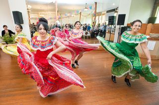 Marcus Larson/News-Register##From left, Ana Domiaguez, Laura Landeros, Litzy Mendoza, and Jennifer Gonzales perform a traditional folk dance during last weekend's Fiesta en la Plaza.