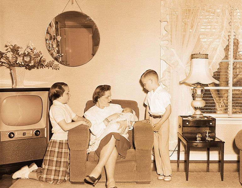 News-Register file photo##May 7, 1955. But mom, She's so little — Just nine days old on Mother's Day will be Marsha Jean Colvin, daughter of Mr. and Mrs. C.E. Colvin. Older daughter, Carolyn, 10, and son, Mike, 6, look with wonder at their tiny baby sister held by Mrs. Colvin. Mother's Day will have special importance this year in the Colvin family.