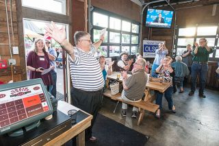 Marcus Larson/News-Register##After returning from the Clerks Office, Mayor Rick Olson receives applause from the crowd gathered at the Grain Station, for his 2,459 vote lead in the Yamhill County Commissioners race over incumbent Allen Springer.