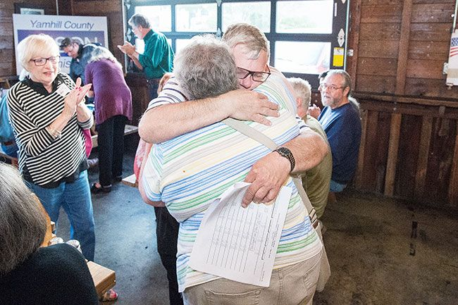 Marcus Larson/News-Register##After arrive back at the Grain Station party, Mayor Rick Olson hugs his wife, Candy, celebrating his early lead in the Yamhill County Commissioners race.