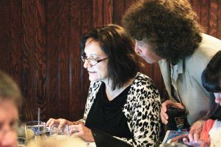 Rockne Roll/News-Register##From left, McMinnville School District finance director Susan Escure and superintendent Maryalice Russell check election results online at an election night party for supporters of the McMinnville school bond at Golden Valley Brewery  on Tuesday, May 17.