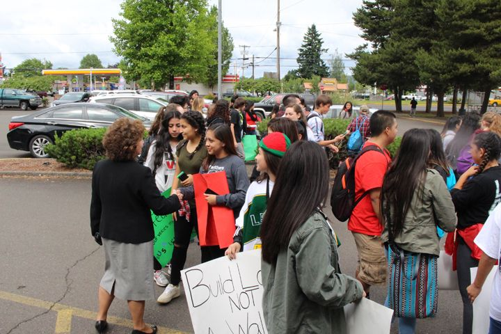 Laurie Fry/Courtesy MSD##McMinnville Superintendent Maryalice Russell shakes hands with Mac High students who organized Friday s walkout. Several hundred students walked to downtown in a demonstration against racism, and then rallied at the district office, where Russell addressed the crowd.