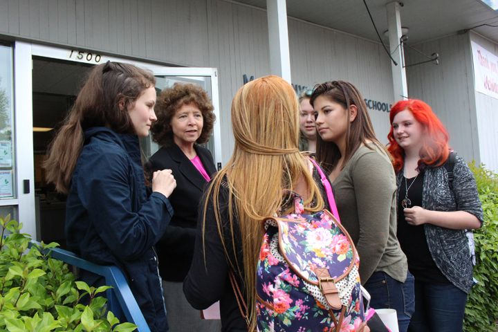 Laurie Fry/Courtesy MSD##McMinnville Superintendent Maryalice Russell talks to students after a brief rally at the district office.