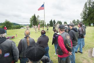 "Marcus Larson / News-Register##Members of the American Legion Riders gather at the Yamhill-Carlton Pioneer Cemetery on Memorial Day. The bikers' jackets bear patches with messages such as ""Freedom is not free."""