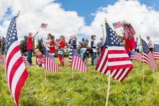 Rusty Rae/News-Register##McMinnville Christian Academy students posted nearly 6,000 flags in 2019 in honor of Oregonians who died in military service.