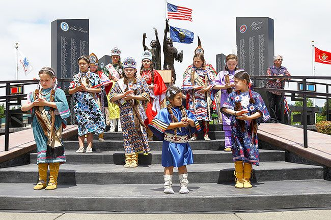 "Michelle Alaimo/Courtesy of Smoke Signals##The Confederated Tribes of Grand Ronde Royalty perform ""The Lord's Prayer"" in sign language during the Tribe's 13th annual Memorial Day Ceremony held