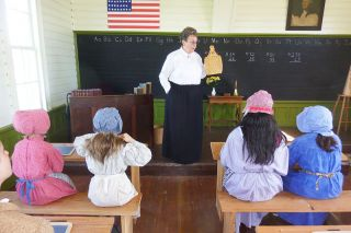 Starla Pointer/News-Register##Playing an 1800s teacher, Carolyn Stastny teaches Dayton Grade School students.