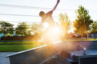 Rusty Rae/News-Register##Local skateboarder Evan Armstrong practices a move Wednesday evening, taking advantage of the ample sun at the skateboard park at  Discovery Meadows Community Park. Skateparks throughout the county reopened under Phase 1 guidelines; however, many park facilities and all playgrounds remain closed.