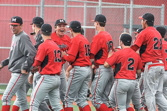 Robert Husseman/News-RegisterThe McMinnville baseball team celebrates its victory over North Salem on Wednesday.
