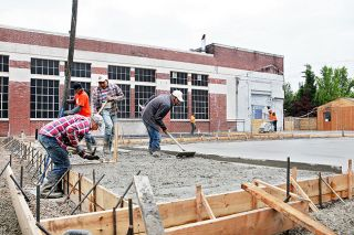 Rockne Roll/News-Register##Workers from Jafco Concrete pour the foundation for the expansion of Elizabeth Chambers Cellar facility in downtown McMinnville on Thursday, May 26.