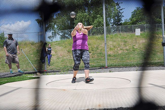 Robert Husseman/News-Register##Lakeridge senior Maddie Rabing takes her sixth and final attempt in the girls  hammer throw at the 2016 Oregon State High School Hammer Championships Sunday.