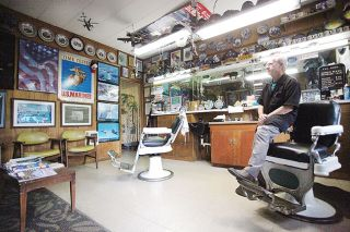 Rockne Roll/News-Register##Walt Fulcher's barbershop is filled with military-themed toys and memorabilia. He has more at home, he said; his wife suggested he take part of the collection to his shop.