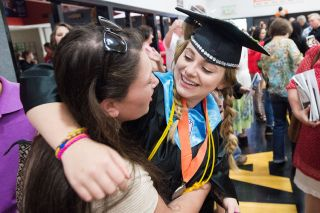 Marcus Larson/News-Register##Willamina graduate Olive Vinson shares a hug with her cousin, Stella Schaefer, at the conclusion of the ceremony.