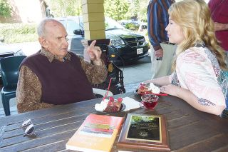 Starla Pointer/News-Register##Railroad buff and rails-to-trails supporter Gordon Zimmerman talks with Ivory