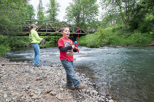Marcus Larson/News-Register##Grayson Goings and his mother, Courtney, enjoy a day of fishing at Willamina Creek in Blackwell Park. Several of the county parks have water access.