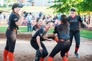 Marcus Larson/News-Register ## Yamhill-Carlton softball players (from left to right) Taylor Stepp, DeLaney Ogden, Emily Drevdahl, Elayna Apuya and Megan Gaibler celebrate during the Tigers' 4-1 victory over Henley Friday.