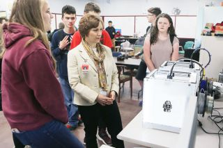 Rockne Roll / News-Register##Dayton High School student Grace Adams, left, explains how the school s 3-D printers work to Suzanne Bonamici during the congresswoman s visit Tuesday.