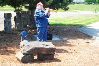 Paul Daquilante / News-Register##Robert  Thornburg plays his trumpet during the Memorial Day ceremonies in Grand Ronde.