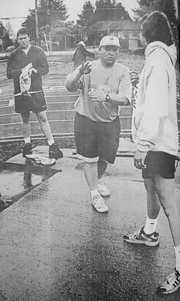 News-Register fileJim Barks works with McMinnville High School discus throwers during a 1996 practice.