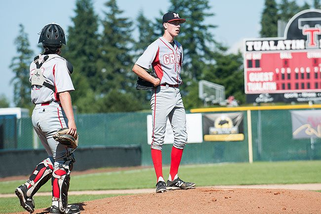Marcus Larson/News-RegisterMcMinnville pitcher David Brosius (right) was named first team all-conference.