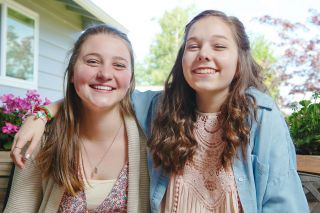 Rockne Roll/News-Register##Emma Gardner and Anna Johnson have become good friends since both were chosen as Rotary exchange students to Brazil. Although they'll spend the year in different parts of the country, they are preparing for the trip together.