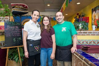 Marcus Larson / News-Register ## Nelva and Jesus Galvin and their youngest daughter, Sophia, at their Mazatlan restaurant. Sophia is starting to help out in the restaurant, as are her older siblings, Salma and Alan.