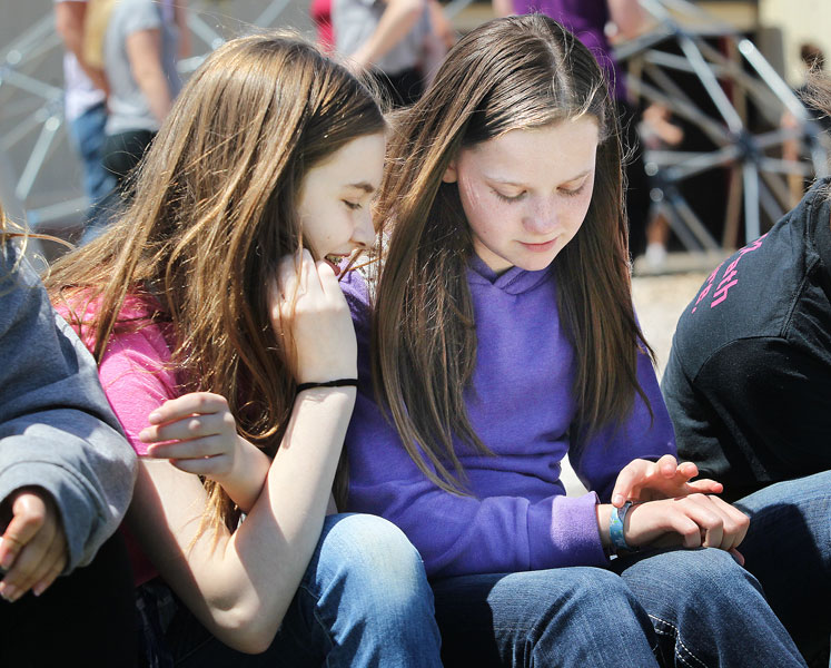 Rockne Roll/News-Register##Kaylee Williams, right, shows classmate Ashley Dickens her media alert bracelet during recess at Yamhill-Carlton Intermediate School. Kaylee was recently diagnosed with diabetes.