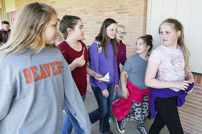 Rockne Roll/News-Register##Kaylee and her classmates head to drama class. She keeps a small backpack with her at all times. It contains the sixth-grader's blood glucose meter and other diabetic testing supplies, her insulin auto-injector and a supply of high-sugar snacks, such as fruit juice and candy.