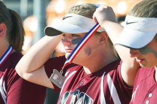 Rockne Roll/News-Register##Dayton senior Rachael Fluke puts on her second-place medal following the Pirates' loss to Rainier in the OSAA Class 3A Softball state championship game at the Oregon State University Softball Complex in Corvallis on Friday, June 3.