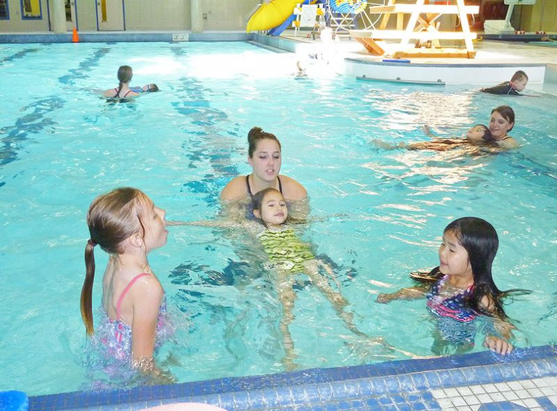 Emily Hoard/News-Register##McMinnville Aquatic Center instructor Malia Riggs teaches floating techniques to Taelor Clausse, Elizabeth