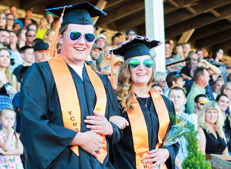 Michaela Fujita-Conradsl/News-Register##Christian VanderMeide, left, and Tayler Proebstel smile as they enter their graduation ceremony at Yamhill-Carlton High School on June 7.