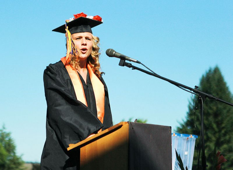 Michaela Fujita-Conradsl/News-Register##Emily Drevdahl reminisces about Yamhill-Carlton High School during her salutatorian speech Sunday.