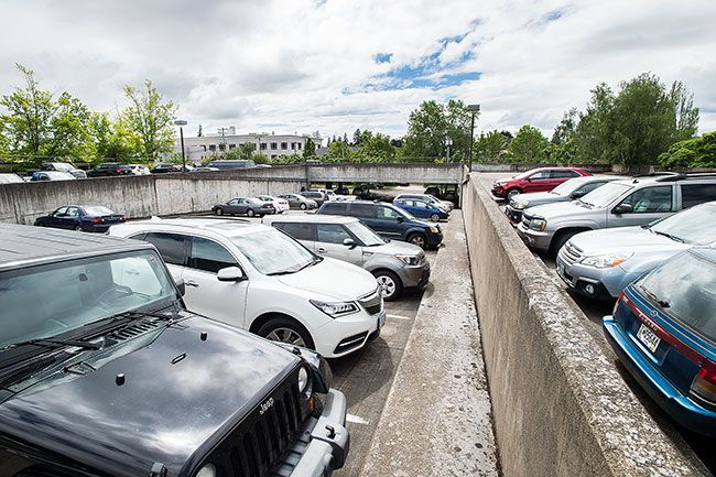 Marcus Larson / News-Register##Cars fill the paraking garage at Fifth and Evans streets.