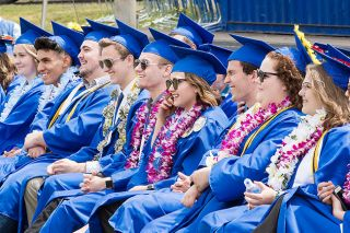 Marcus Larson / News-Register##Members of the Amity High School class of 2919 listen to speakers at their Saturday commencement ceremony.