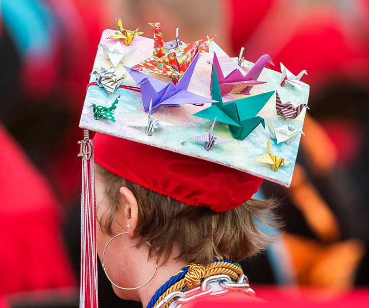 Marcus Larson / News-Register##Graduating senior Delanie Crabtree adorns her mortarboard with origami cranes for McMinnville High School s Friday night graduation.
