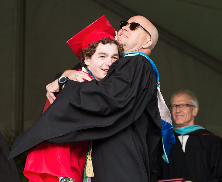 Marcus Larson / News-Register## McMinnville School Board member Carson Benner shares a hug with his son, Prescott, as the new graduate walks across the stage to receive his diploma.