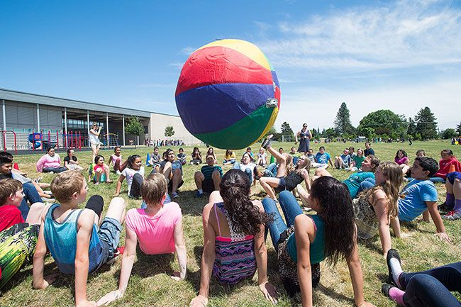 Marcus Larson/News-Register##Using their feet to keep a giant beach ball in the air, Sue Buel Elementary students enjoy a game of crab soccer on one of the final days of the 2014-15 school year.