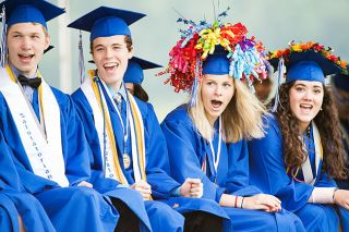 Marcus Larson/News-Register##Amity High graduates from left, Dylan Stearns, Daniel Mather, Macey Walker and Bailie Jacobo-Safranski react to comical refrences to their classmates made by the commencement speaker.