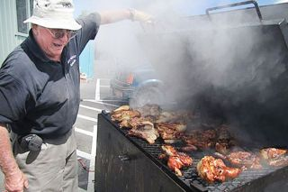 Submitted photo##Ted Mayfield shows off some barbecued chicken during a previous Sheridan Days festival.