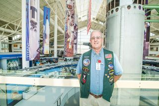 Marcus Larson/News-Register##James Cameron poses next to the Titan II Missile and other exhibits he oversees as a docent at the Evergreen Space Museum.