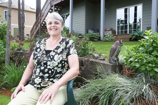 Rockne Roll/News-Register##Teresa Brandon, pictured in the lower portion of her yard in McMinnville.