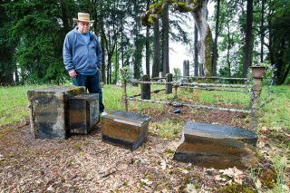 "Marcus Larson/News-Register##Johnny Edwards serves as the caretaker for the Lafayette Masonic Cemetery, where vandals recently pushed over 30 headstones, breaking a number of them. ""It was a sad cemetery before,"" he said. ""Now, it's even sadder."""