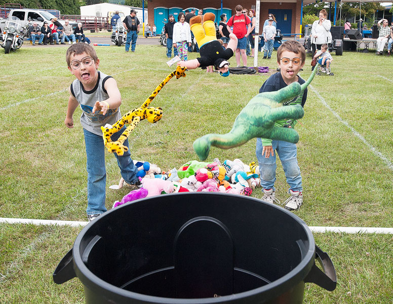 News-Register file photo/Marcus Larson##Cousins Conner Johnson and Michael Perry compete in the children's toy toss contest during last year's