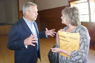 Starla Pointer/News-Register##Destination business consultant Jon Schallert expands on some of his advice as he talks with Cynthia Abel, owner of the Carlton Main Street House vacation rental.
